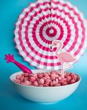 Colorful bowl cereal with cute flamingo. Colorful paper craft decoration in a breakfast, bowl of cereal with milk. Pink, red, blue royalty free stock photos