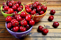 Colorful bowl with cherries fruit Stock Image
