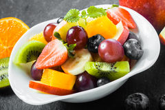 Colorful bowl of healthy tropical fruit salad Stock Photography