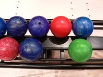 Colorful Bowling Balls. Bowling balls on a rack Royalty Free Stock Photo