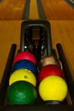 Colorful bowling balls waiting for use Royalty Free Stock Photos