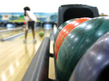 Colorful bowling hall & balls. Close-up of colorful bowling lanes & balls Royalty Free Stock Photo