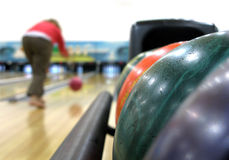 Colorful bowling hall & balls. Close-up of colorful bowling lanes & balls Royalty Free Stock Photography