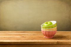 Colorful bowls with apple Stock Photos