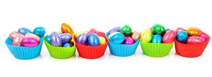 Colorful bowls with easter eggs Stock Photos