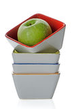 Colorful bowls with green apple Royalty Free Stock Photography