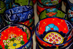 Colorful bowls at Mexican pottery market. Stock Photo