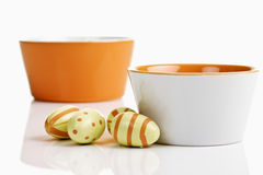 Colorful bowls with painted Easter eggs Royalty Free Stock Photography
