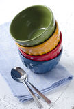 Colorful bowls. Stack of colorful bowls and spoons Stock Images
