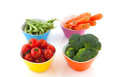 Colorful bowls with vegetables Royalty Free Stock Photos