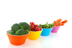 Colorful bowls with vegetables Stock Photo