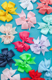 Colorful bows on blue Royalty Free Stock Images