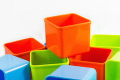 Colorful boxes. On white background, orange on top Stock Photography