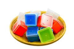 Colorful boxes in basket Stock Images