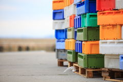 Colorful boxes plastic crates containers for fish Royalty Free Stock Image