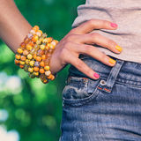 Colorful bracelet on a womans' hand Royalty Free Stock Photo