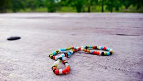 Colorful bracelet on wood Stock Photography