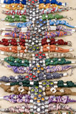 Colorful Bracelets. A row of colorful bracelets with different types of stones Stock Photo