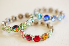 Colorful bracelets in a jewelry. Colorful bracelets on display in a jewelry store Royalty Free Stock Photo