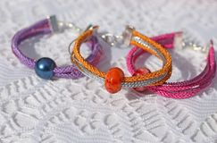 Colorful bracelets and other craft items of jewelry Royalty Free Stock Photo