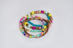 Colorful bracelets on a white background Royalty Free Stock Photography