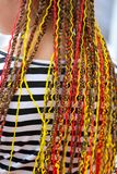 Colorful braids on the girl`s head.  stock photography