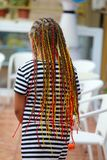 Colorful braids on the girl`s head.  royalty free stock photography