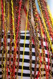 Colorful braids on the girl`s head.  royalty free stock image