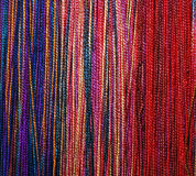 Colorful Braids of Wool Thread. A background pattern of blue, purple, yellow, red and pink braids made of wool fibers Stock Photography