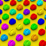 Colorful brain illustration patter. Original low poly brain illustration pattern on yellow background Royalty Free Stock Images