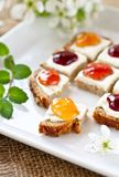 Colorful breakfast. Slice of bread with different kinds of jam Stock Image