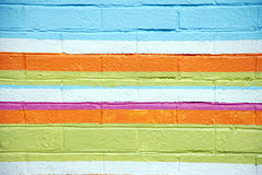 Colorful Brick Wall. Brick wall painted with horizontal stripes Stock Photography