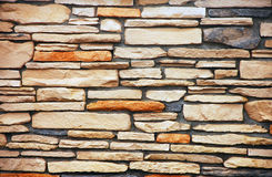 Colorful brick wall. Colorful brick and stone wall with brown textures Stock Images