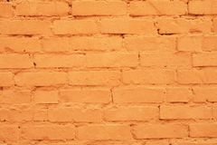 Colorful brick wall. A Brick wall painted orange Stock Images