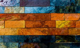 Colorful Brick Wall. With many orange and blue nuances Royalty Free Stock Photo