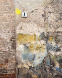 Colorful brick wall and plate with a number seven Stock Photography