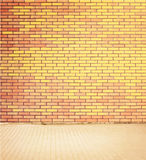 Colorful brick wall texture with walkway. Royalty Free Stock Image
