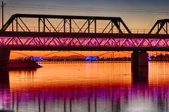 Colorful Bridge. Colorful light rail bridge across the Salt River in Tempe Arizona at sunset Stock Image