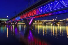 Colorful Bridge. Colorful light rail bridge across the river at sunset Royalty Free Stock Photography