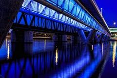 Colorful Bridge. Colorful light rail bridge across the river at sunset Royalty Free Stock Image