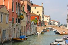 Colorful bridge across canal in Venice Royalty Free Stock Photography