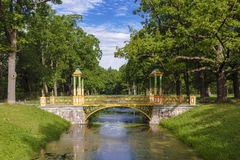 Colorful bridge in the Chinese style in the Alexander Park of Tsarskoye Selo Stock Photos