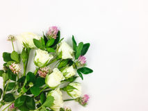 Colorful bright bouquet made of roses and clover flowers. Flay lay, top view Royalty Free Stock Photography