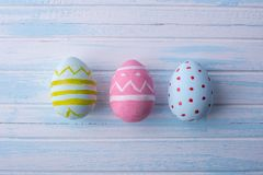 Colorful Easter eggs hand painted on a blue background. Holiday spring card. Colorful bright Easter eggs hand painted on a blue background. Holiday spring card Stock Image