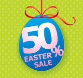 Colorful bright Easter Sale background poster with egg and discount percentage. Easter Sale egg shaped tag with bow ribbon and discount persentage sign Stock Photography