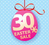Colorful bright Easter Sale background poster with egg and discount percentage. Easter Sale egg shaped tag with bow ribbon and discount persentage sign Royalty Free Stock Photo