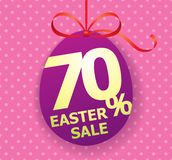 Colorful bright Easter Sale background poster with egg and discount percentage. Easter Sale egg shaped tag with bow ribbon and discount persentage sign Royalty Free Stock Images
