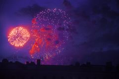 Colorful bright fireworks on roof top silhouette, magic holiday Royalty Free Stock Photo