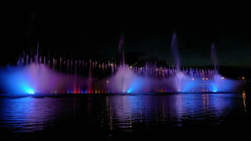 Colorful bright fountain with beautiful reflection stock video