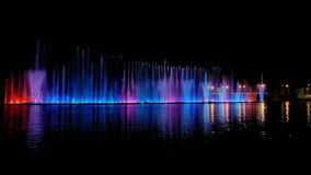 Colorful bright fountain with beautiful reflection stock video footage